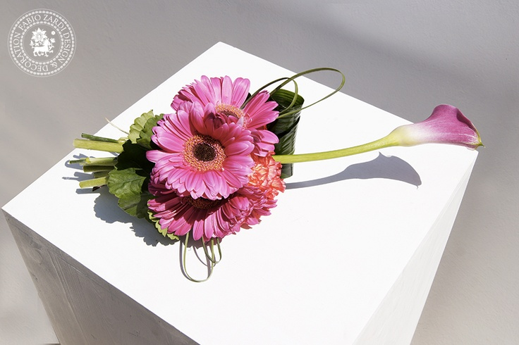 Small bouquet with calla lilies, carnations, gerberas and leaves. Made for a photo shooting at Avaton Resort & Spa, Imerovigli.