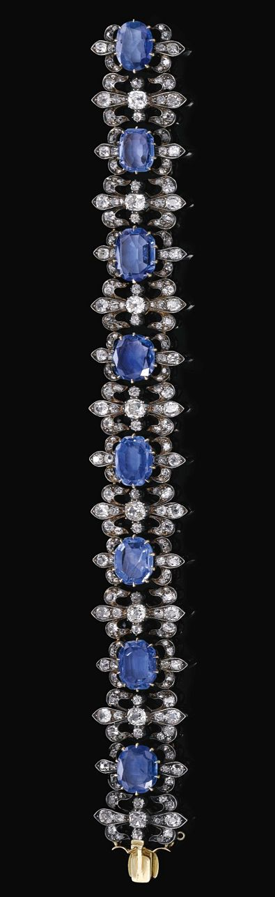 SAPPHIRE AND DIAMOND BRACELET, LATE 19TH CENTURY    The articulated bracelet composed of eight oval to rectangular modified sapphires framed by fleur de lys motifs set with cushion-shaped, circular-, single-cut and rose diamonds, length approximately 184mm.