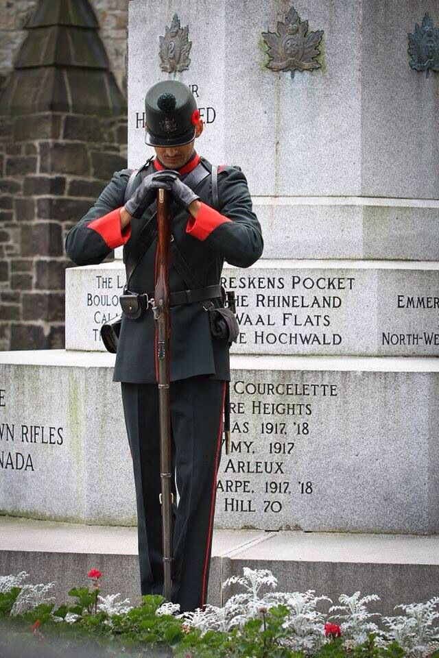 A Skirmisher from The Queen's Own Rifles of Canada at the Cross of Sacrifice.