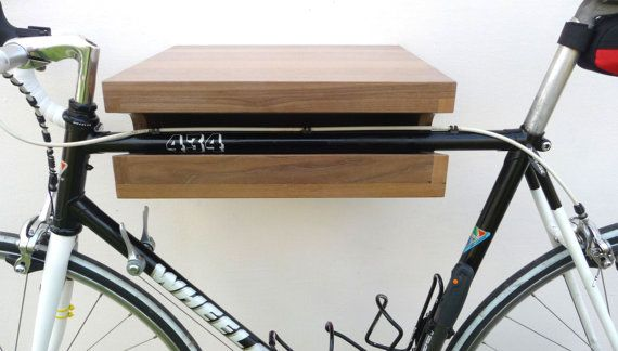 The shelf is made from solid walnut wood. It is finished with natural oil. Intended for inside usage. Fits for bikes with 56 cm handelbars width