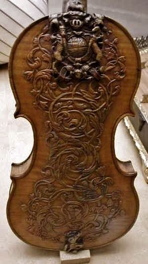 Such beauty - Ornately carved 17th century violin by Luther Ralph | http://awesomepaiting.blogspot.com
