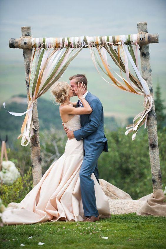 rustic country ribbon wedding arch / http://www.himisspuff.com/ribbon-wedding-ideas/2/