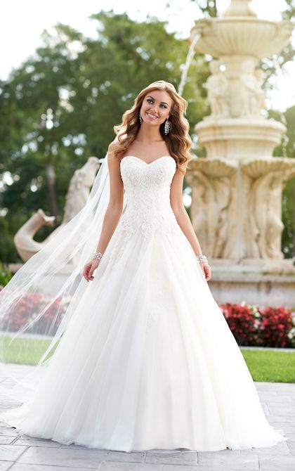 A twist on tradition, this elegant A-Line bridal gown from the Stella York designer wedding dress collection is made from dramatic Diamanté-embellished corded Lace over light-as-air Tulle. Inspired by the world's hottest red carpet trends, this Stella York bridal gown is handcrafted with stunning detail that is ladylike yet modern. Choose between a zipper closure or a lace up back.