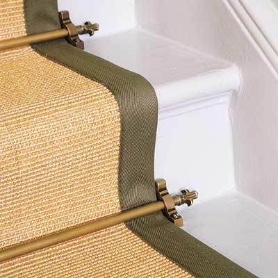 Before pneumatic carpet nailers, handsome metal rods secured stair runners. Similar to shown: Zorrods Standard Stair Rod in oil-rubbed bronze, about $19; Floors and Surfaces. Photo: Dominic Blackmore/IPC Images | thisoldhouse.com