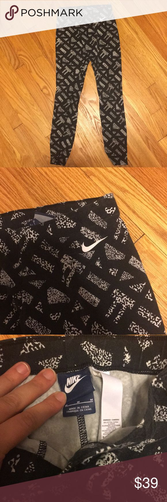 Nike running tights Excellent used condition. Great for workouts. Black slightly faded but cute pattern. Nike Pants Track Pants & Joggers