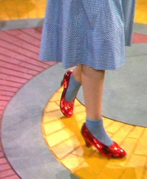 I am so glad they decided to change the color of the shoes from silver to red. The impact is much greater this way; they never would have popped on the screen if they were silver.