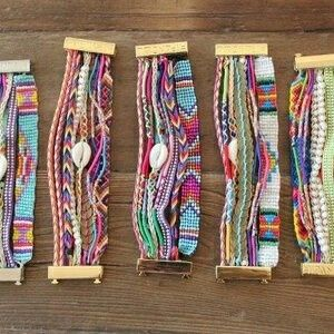 A lovely combination of weaving and plaiting/wrapping