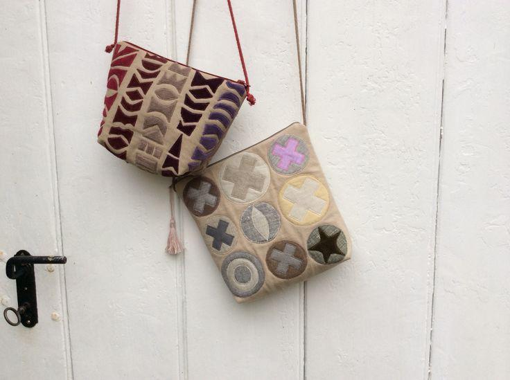 Taschen mit handgenähten Applikationen