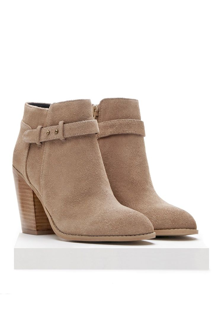 Heeled ankle bootie with cool side buckles in a soft neutral suede