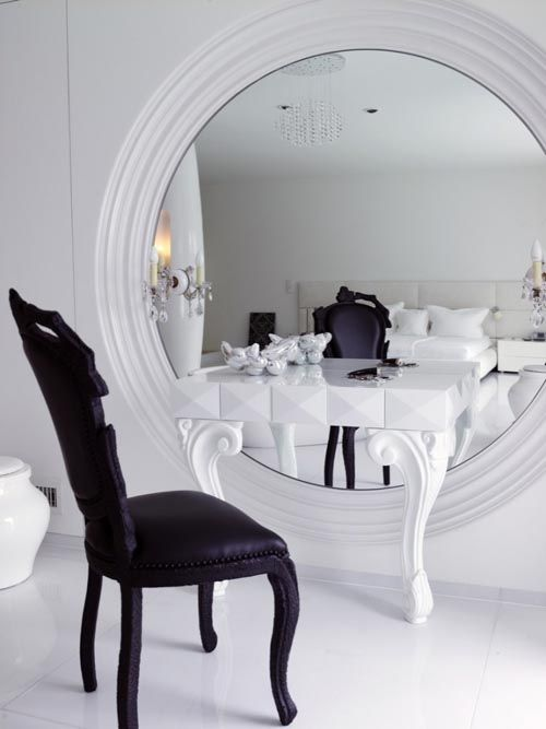 Modern Dressing Table Designs - love the idea of the oversized round mirror behind dressing table