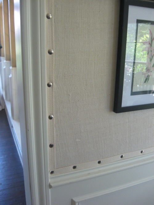 Burlap Wallpaper with nailhead trim. This might be an inexpensive wall covering for the attic bedroom. Try it on the ceiling.