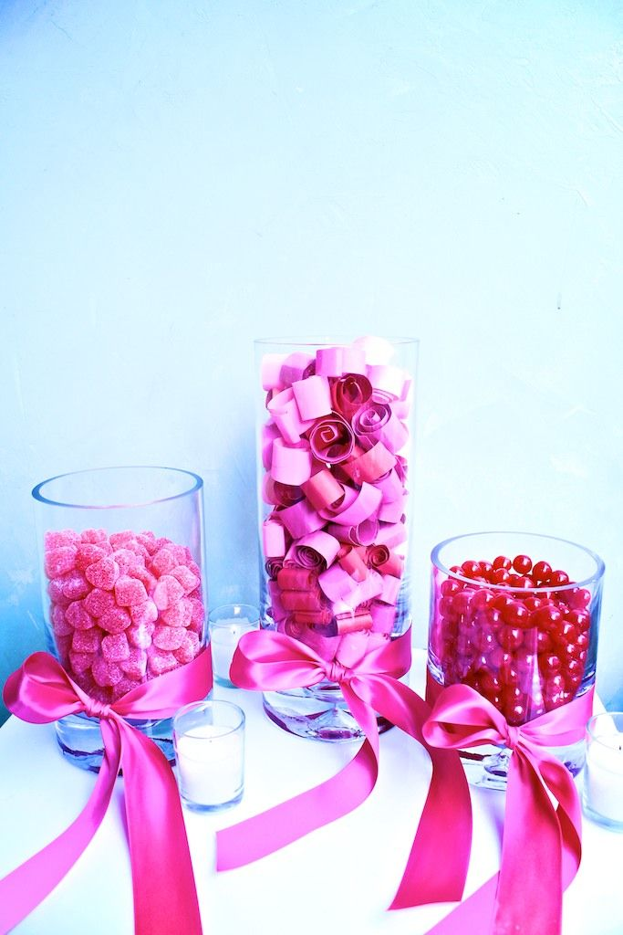 """Debi Lilly Design Valentine Centerpiece - candy jars surround Sweet Rewards jar filled with scrolls handwritten. """"One night at the movies"""", """"Family day at Navy Pier!"""", """"Good for one night of dancing."""" ..."""