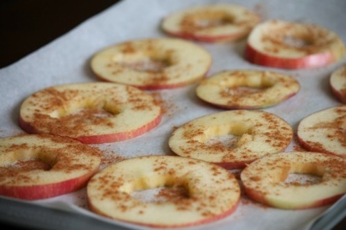 These baked apple chips from Delighted Momma are such a perfect fall snack and they will make your entire home smell AMAZING.  What you need:  2 apples  Cinnamon  Directions:  Preheat oven to 275 degrees.  Remove apple core. (I somehow always screw this up, so here is a guide)   Thinly slice the entire apple.  Line a cookie sheet with parchment paper and place apple slices on it.  Sprinkle with cinnamon.  Bake for two hours. At the end of hour one, flip them over so they bake evenly.