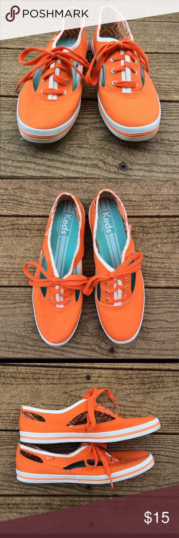 Keds cut-out orange sneakers Keds side cut-out orange sneakers. Great condition; some scuffs on sides (could be scrubbed off), very mild wear on soles (see photos). Worn once to a University of Tennessee football game (go Vols!). Keds Shoes Sneakers