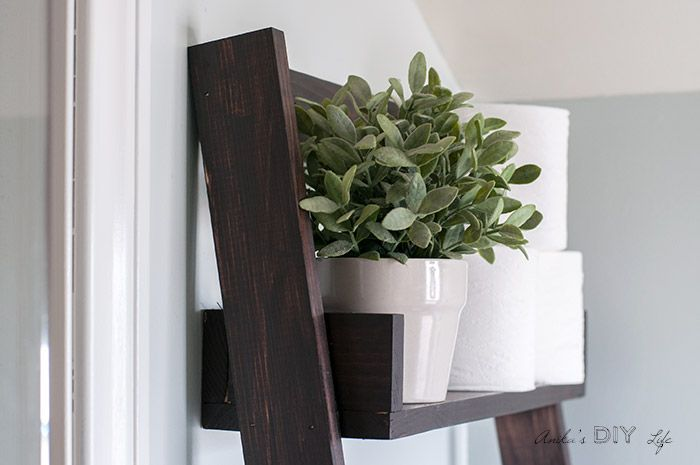 Flower+pot+with+faux+greenery+on+floating+ladder+shelf.