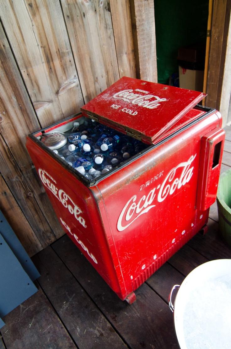 Antique Coca Cola fridge. Steven would love if we had glass bottles of coke.