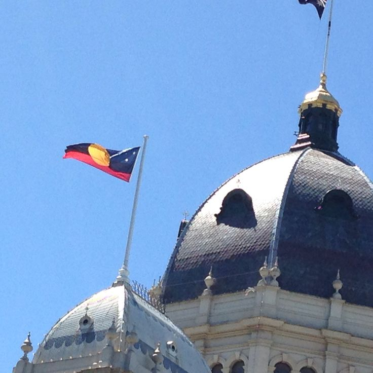 Aboriginal flag flying proudly over the Royal Exhibition Building, a UNESCO World Heritage site