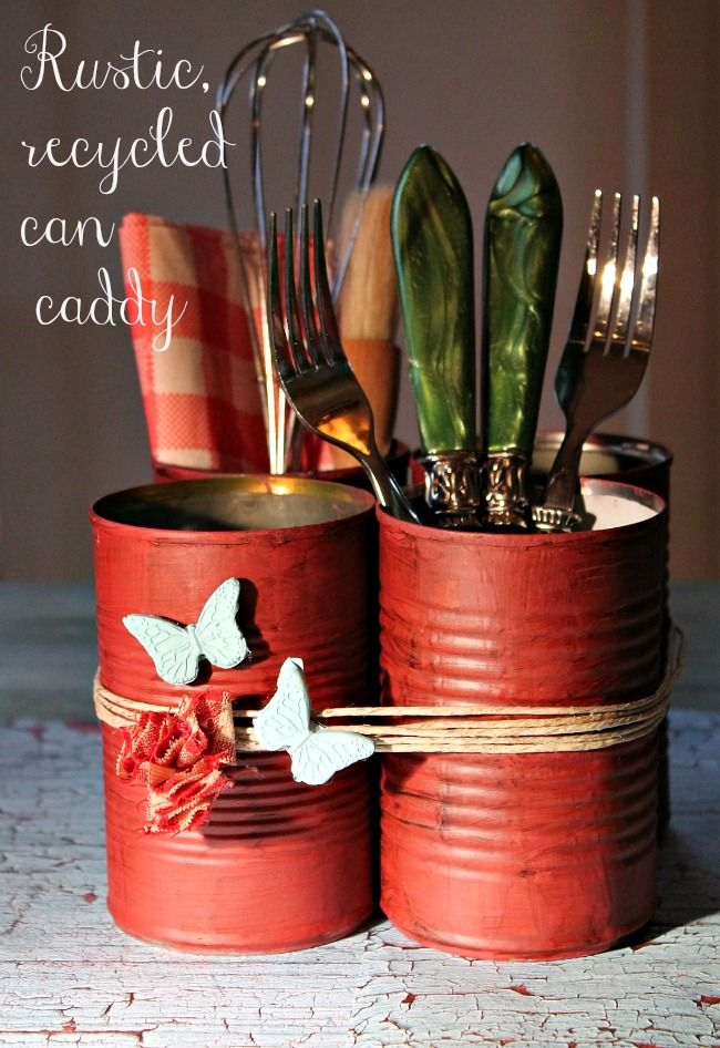 painted recycled cans into silverware caddy- cute!