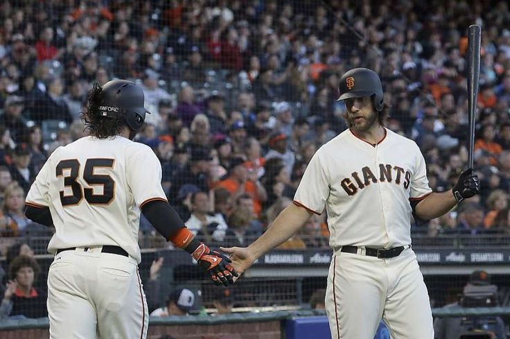 San Francisco Giants' Brandon Crawford (35) is congratulated by Madison Bumgarner after scoring against the Pittsburgh Pirates during the second inning of a baseball game in San Francisco, Tuesday, July 25, 2017. Photo: Jeff Chiu, Associated Press