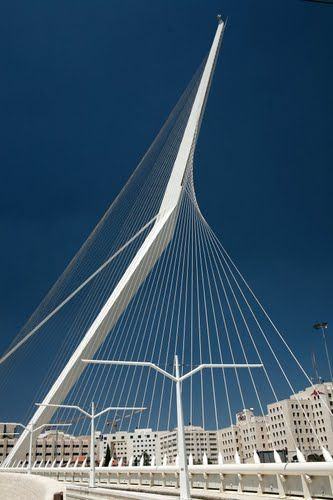 Jerusalem Chords Bridge or Bridge of Strings; Light Rail Bridge by Santiago Calatrava, Architect. This newest landmark is the city's tallest structure and was designed to invoke King David's harp with 66 steel cables as its strings. Jerusalem, Israel