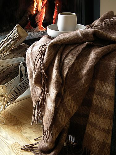 At home I have spare blankets/quilts in the living room covering the arms of the sofas. It nice in winter to be able to warm yourself up in them! Might help to counteract the heating problem a little too!: