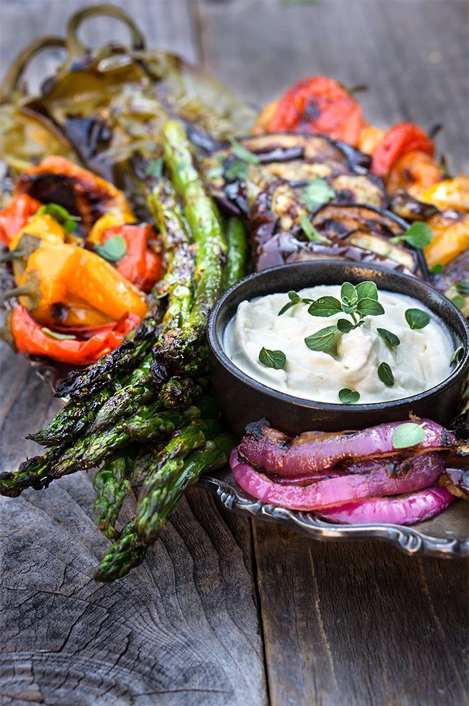 Marinated grilled vegetables with whipped goat cheese - eggplants, peppers, zucchini, asparagus, and onions, marinated and grilled till soft on the inside and charred on the outside