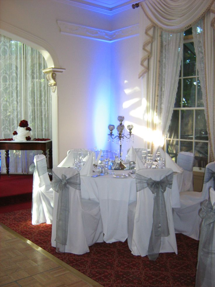 Silver theme reception setup with coloured lights in the corners of the room