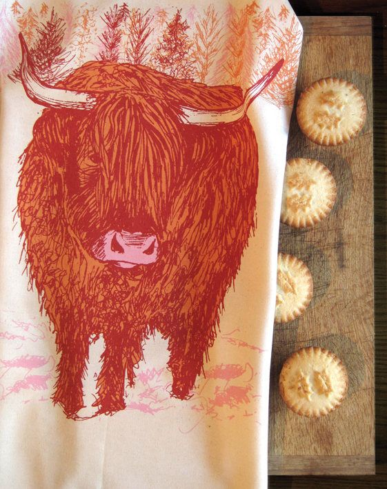 Highland cow dish towel on our #stag shop adds a festive touch in the kitchen