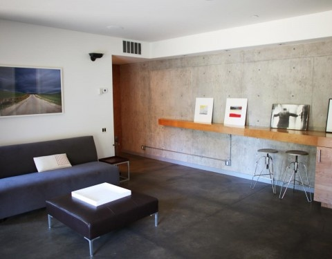 CCS Architecture, Alpine Meadows residence: interior views showing concrete floors and walls.