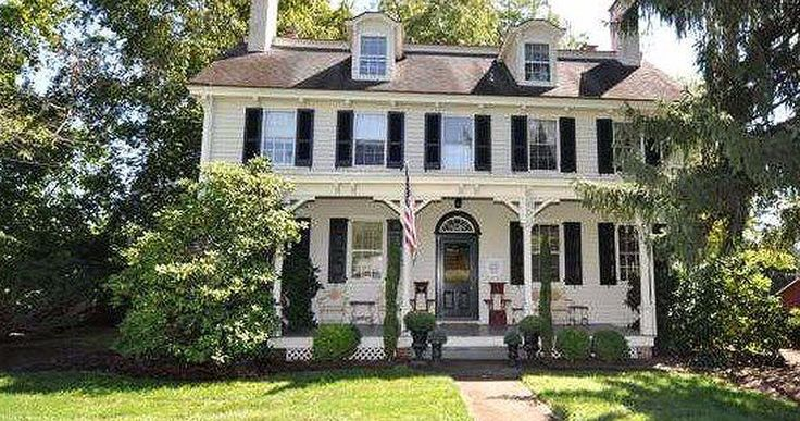 Originally built in 1835, this historic farmhouse features a large front porch…