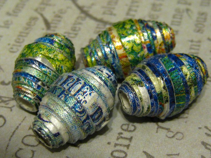 Paper beads I rolled by adhering a fancy napkin to silver card stock so the sliver shines through the fancy napkin when finished.