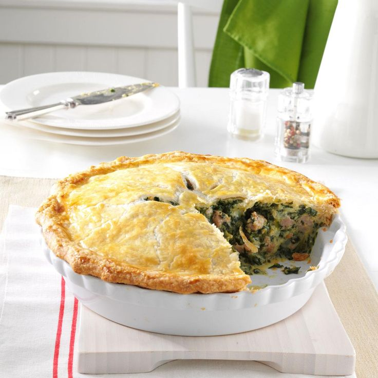 Italian Sausage and Spinach Pie Recipe -The basic recipe came from my mother, but I've added a few ingredients. The flavors blend so well, and it even tastes good cold. This makes a hearty supper, especially when you serve it with a side of pasta. —Teresa Johnson, Peru, Illinois