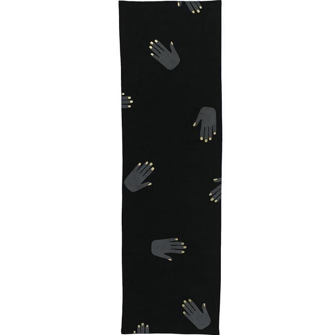 black table runner with painted silver hands and gold nails