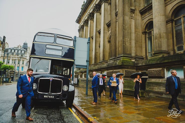 Wedding day transport - stunning black vintage bus outsite the town hall in Leeds  The Faversham Leeds, Leeds University, University of Leeds, Leeds Centre Yorkshire Urban Wedding. Nightclub wedding. Unique wedding venue. Leeds Town Hall   Want to see more? www.jamesandlianne.com Yorkshire Based Wedding Photographers Capturing the Day how You remember it
