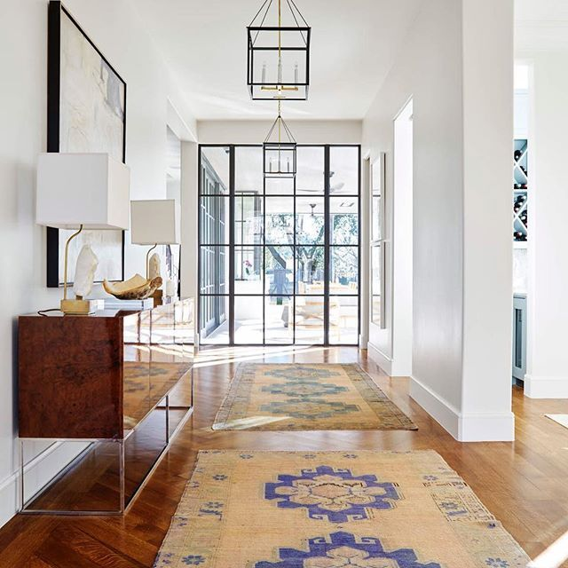 interior design by jenkins interiors | burl wood console | antique rugs | stone lamps with square shade from blue print | blueprintstore.com