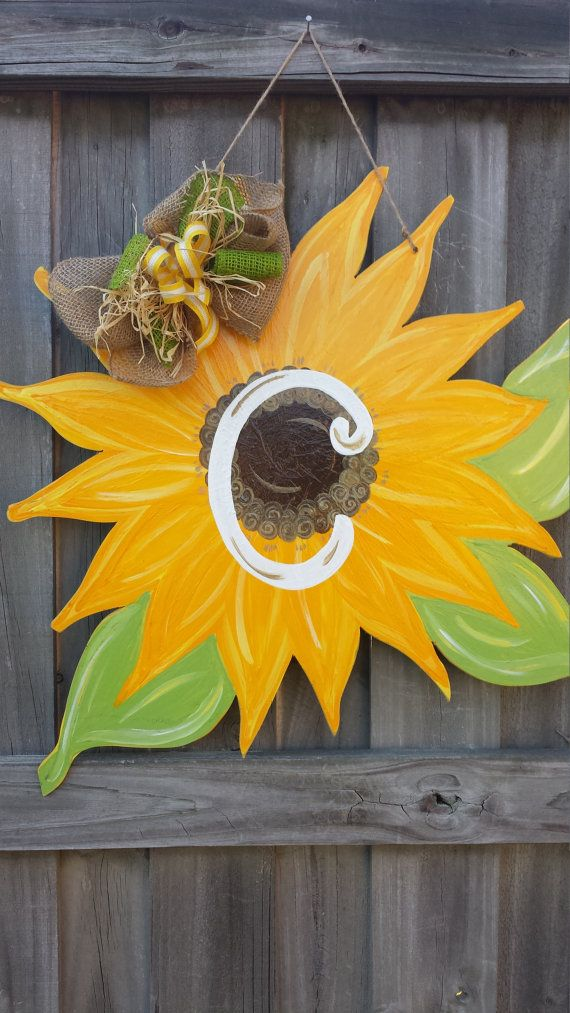 Custom Painted Sunflower Door Hanger by CurlyQsCreation on Etsy .... Look it already has a C on it!!