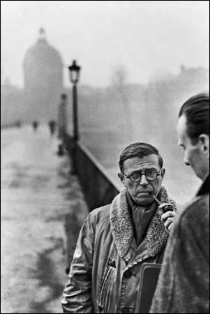 Jean-Paul Sartre (left) with the architect Jean Pouillon by Cartier Bresson