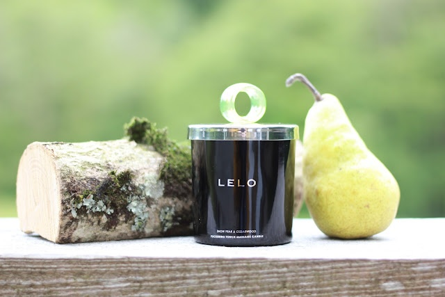 Immerse yourself in the radiant glow of LELO's Flickering Touch Massage Candle - SNOW PEAR & CEDARWOOD