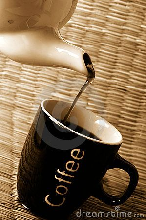 Hot coffee being poured into coffee cup
