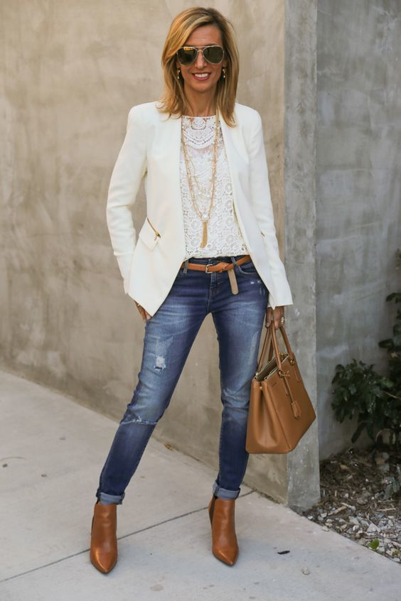 A nicely put together combination of a white jacket and blue ripped skinny jeans will set you apart effortlessly. Round off this look with tobacco leather booties.   Shop this look on Lookastic: https://lookastic.com/women/looks/jacket-long-sleeve-t-shirt-skinny-jeans/18542   — White Lace Long Sleeve T-shirt  — White Jacket  — Tobacco Leather Belt  — Blue Ripped Skinny Jeans  — Tobacco Leather Tote Bag  — Tobacco Leather Ankle Boots