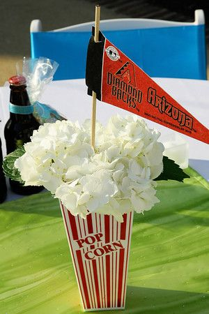 Baseball centerpieces -- flowers in a popcorn container. Clever!