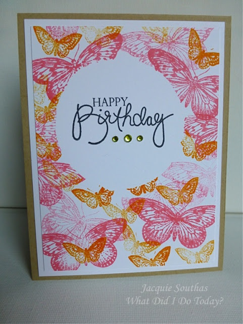 handmade birthday card ... one layer ... center circle masked off and then card stamped with lots of butterflies in pretty shades of pink and orange ... makes me smile ...