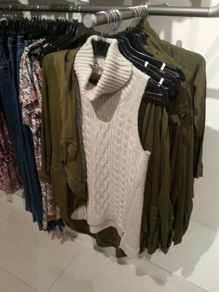 Who else is loving this khaki jacket and vanilla turtle neck knit combo? Love it!