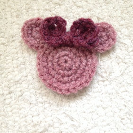 Crochet a Cute Minnie Mouse Applique - Guidecentral Cute Adornment on scarves, hard, headbands for a Minnie Mouse lover.