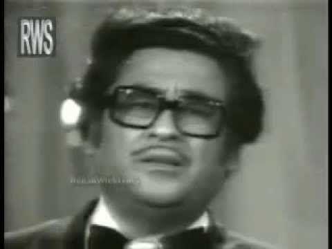 Actual singer: Kishore Kumar Music Composers: Kalyanji and Anandji standing on two sides.