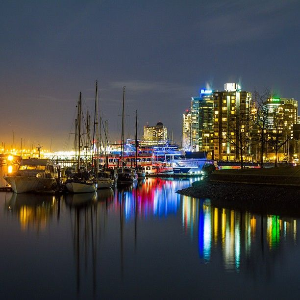 Gorgeous photo of buildings and boat in Coal Harbour - Photo by robot_lyons
