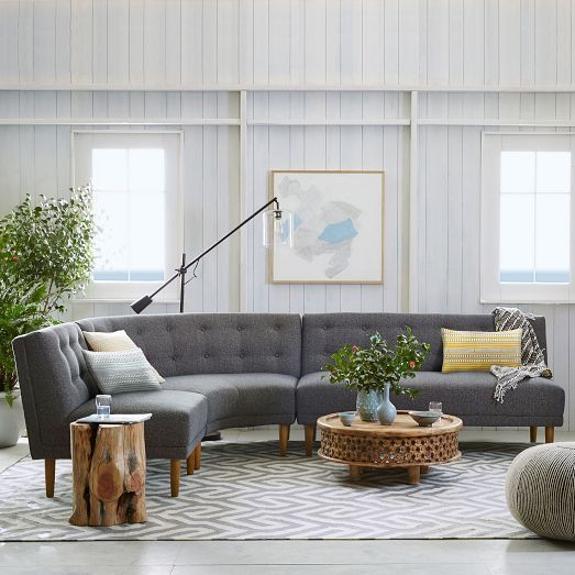 With its curving vintage-style silhouette, tight seat back and button tufting, the Rounded Retro Armless Sectional allows for various configurations, and is great for seating a crowd. Stocked in slate chenille tweed, it makes a mod statement.