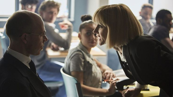 The Inspector (Jami Reid-Quarrell) & Miss Quill (Katherine Kelly) -- Class.S01E02 - ''The Coach with the Dragon Tattoo''  (Class - BBC Series) (Doctor Who - BBC Series) (BBC Three - Photo Gallery: Class - ''The Coach with the Dragon Tattoo'') pic: http://www.bbc.co.uk/programmes/p04c0wx8/p04c0r50 ; episode page: http://www.bbc.co.uk/programmes/p04c1bs4 ; BBC Three - Photo Gallery: Class - ''The Coach with the Dragon Tattoo'' link: http://www.bbc.co.uk/programmes/p04c0wx8