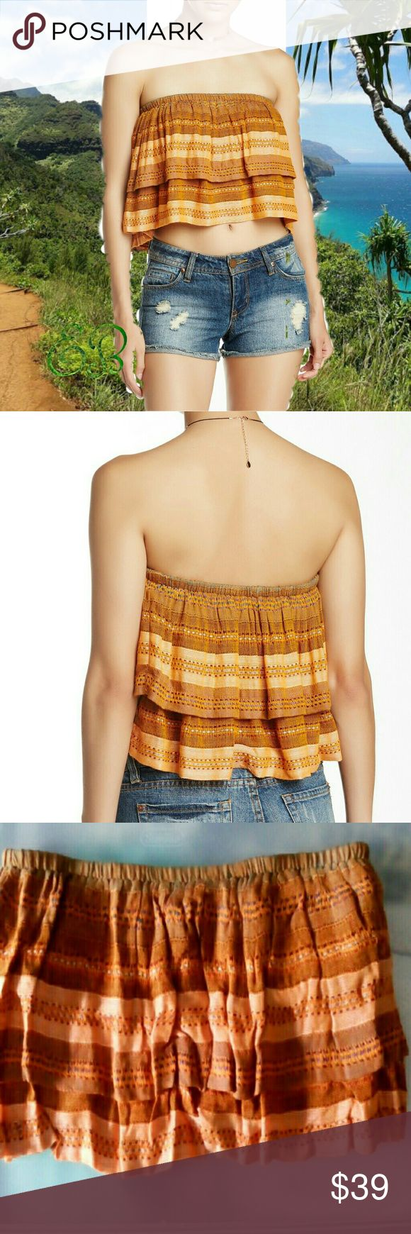 "FREE PEOPLE Indian Summer Orange Bandeau Top Free People Indian Summer Bandeau Tube top  Condition:  NWT  Type: Top Style: Bandeau Size: L Color: Orange Brand: Free People  Features: Tiers Measurements: 33"" Chest 10"" Length  Materials: 100% Rayon Lining 94% Cotton 6% Spandex Country of Manufacturer: India  Closet Note: Tube top with a tiered construction. Bandeau neck. No straps. Top is lined  DD 25.5.17 Free People Tops"