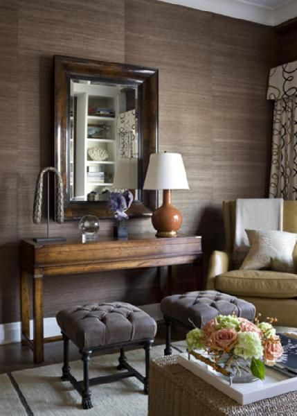 grasscloth walls, double ottomans, patterned window treatments, masculine, layered look.